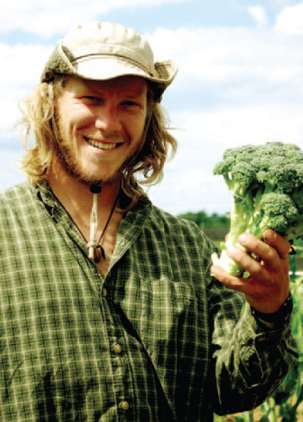 Asbury University Student with Broccoli - Mission Farm