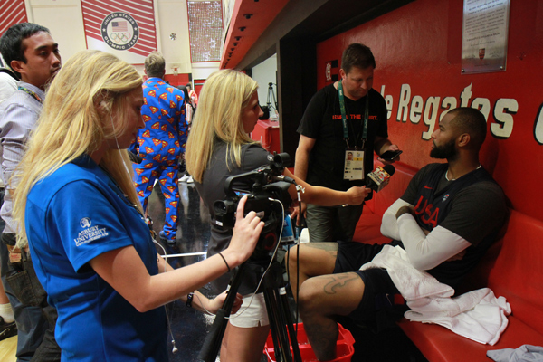 Students interviewing USA basketball player DeMarcus Cousins