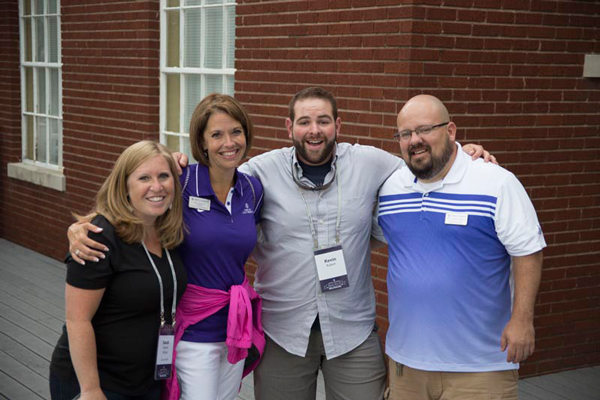 Asbury University alumni posing for a photo with Alumni Office staff