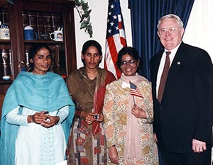 Joe Pitts standing with three women from Pakistan