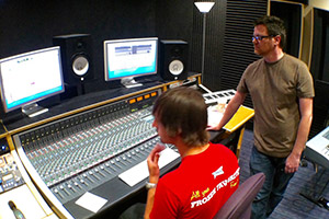 Student and professor working together in the audio control room