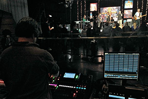 A student using a portable live sound system at a concert