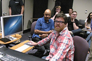 Students and professors using sound mixing equipment