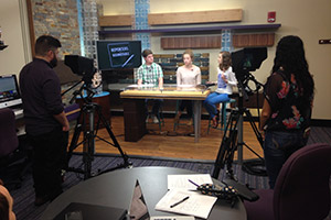 Students recording a broadcast in the Newswatch studio
