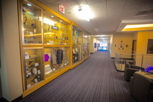 Hallway with glass display cases containing memorabilia