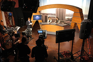 A news show in progress in the TV studio