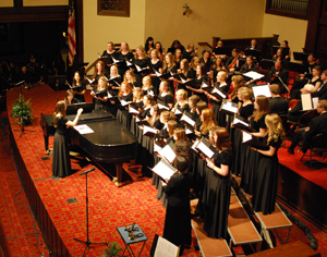 Senior Hope Tellifero conducts the Asbury University Women's Choir during the Homecoming 2012 concert.
