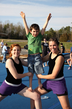 Asbury students Corrin Scheie '16 and Sally Schmachtenberger '13 traveled with the Tumbling Team this spring, presenting a show to children and community groups.