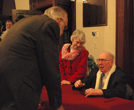 Dr. Gilbert Roller (right) signed copies of his novel, The Healing Horses, after the concert.