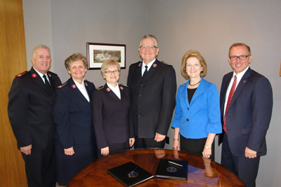 Representatives of The Salvation Army, including (from left) Maj. Rob Lyle, Col. Barbara Hunter, Comm. Sue Miller '72 Swanson and Comm. Barry Swanson, met with Asbury University President Sandra Gray and Provost Jon Kulaga.