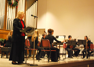 Dr. Marcia Hurlow reads a selection at the 2012 Songs of the Season.