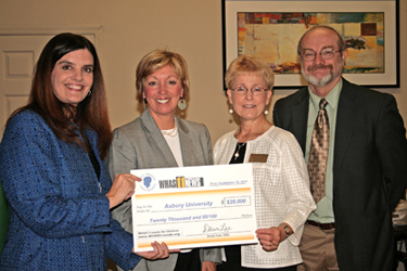 WHAS Crusade CEO Dawn Lee (left) presented the grant to Director of Graduate Education Barbara Kennedy, Associate Professor Becky Oswald and Assistant Professor Rocky Wallace.