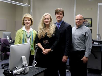From left, President Sandra Gray, Shannon Czaplinski '92 Bailey, Blake Bailey and Dr. Jim Owens '79.
