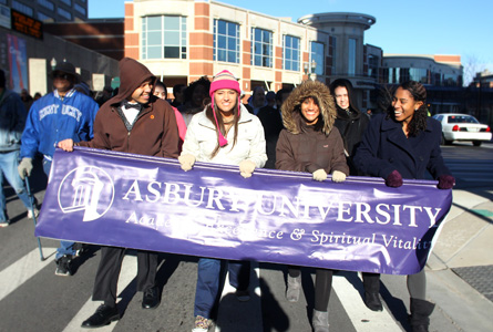 Asbury University freshmen Quentin Carter, Nicole Arens, Alexa Goins and Julia Chin marched through Lexington, Ky., to observe Martin Luther King, Jr., Day. Photo by Joylily Bogle '16.