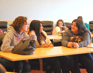 Cassie Petersen, left, talks with new friends at The Call Conference 2012.