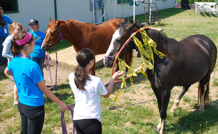 Students attending the Equine camp spent time training young horses in Asbury's Police Mount program.