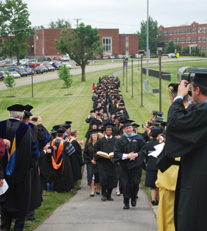 New graduates are led into commencement ceremonies in May 2012.