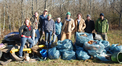 A group of Asbury students pulled hundreds of pounds of trash out of a wooded area used by University and community alike.