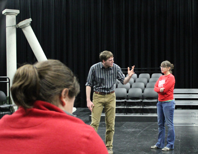 (From left) Stage manager Jennifer Silver '14 helps Joshua Heinlein '14 and Katie McPherson '15 rehearse their lines.""