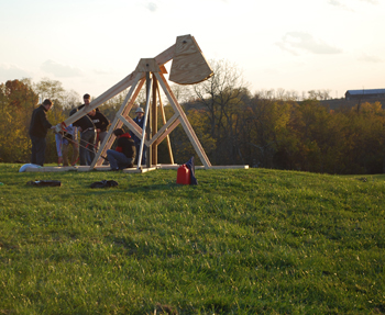 "The men of ""Third Nerd,"" the third floor of Trustees Hall, launched pumpkins from a trebuchet for an appreciative crowd."