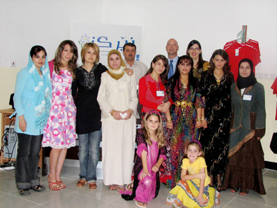 Dr. David Bosch (back row, on right) and his wife, Cynthia (back row) established a women's fitness center in Iraq.