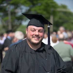 graduate student with cap and gown