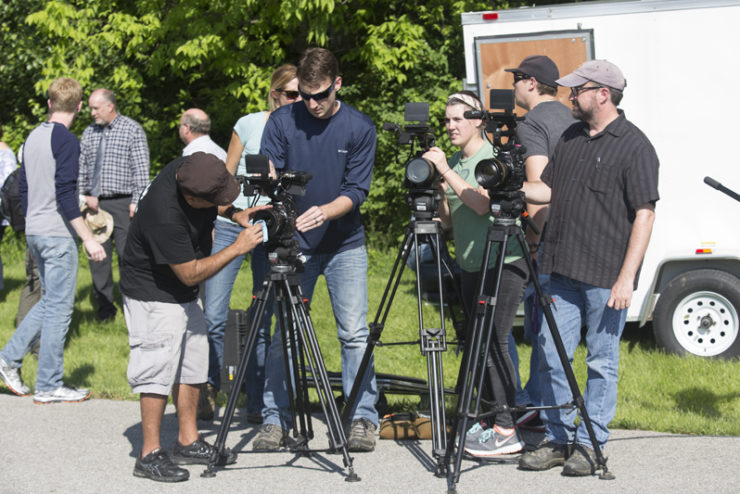 film professionals working with cameras
