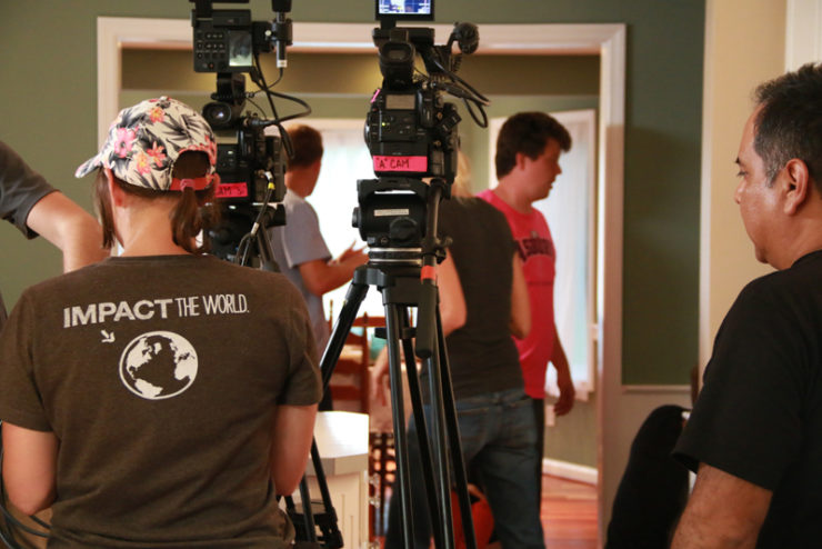 film professionals working with video cameras