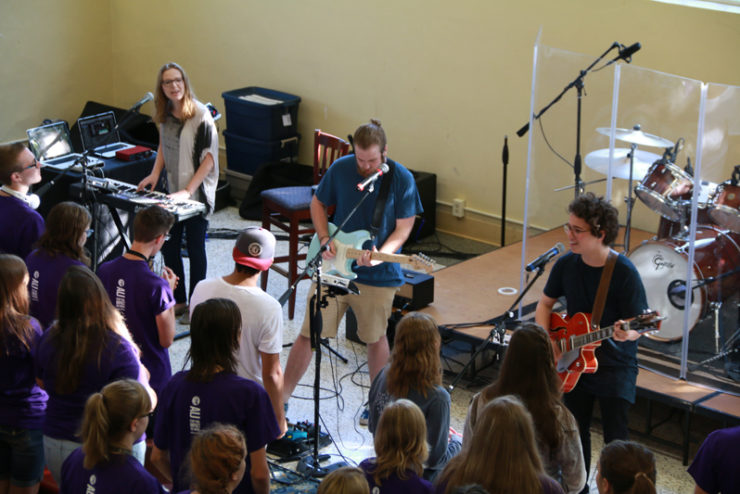 students playing guitars and singing