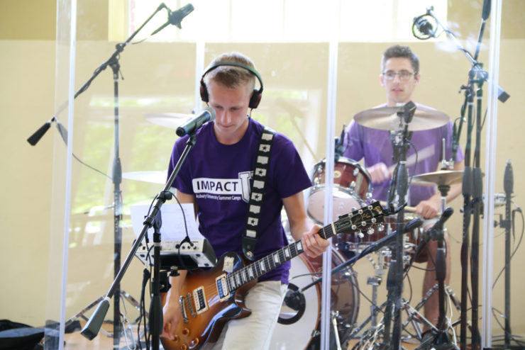 students playing guitars and drums