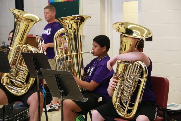students playing tubas