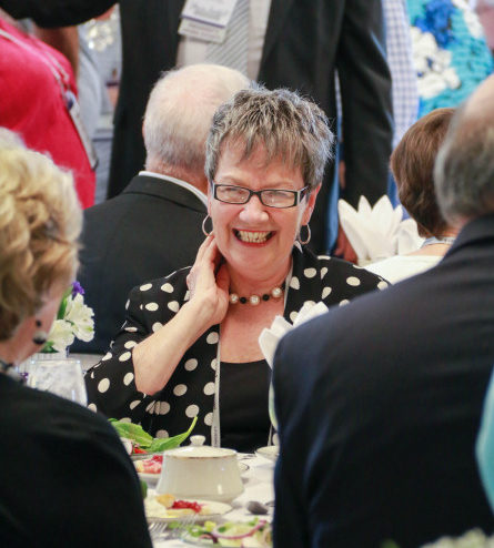 person smiling at a banquet