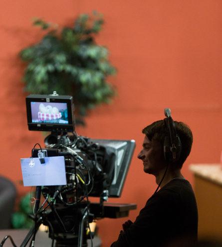 student operating a TV camera