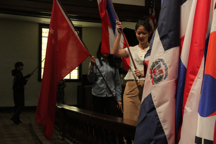 students carrying national flags