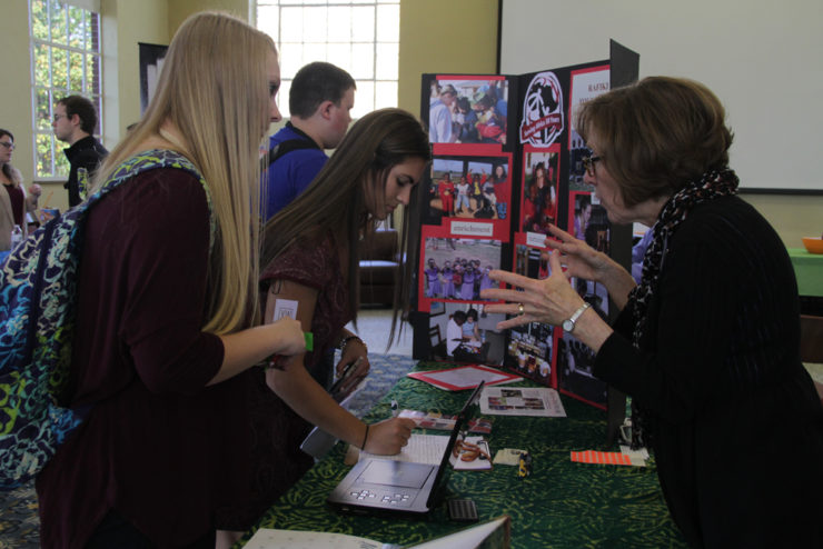 students looking at a display table