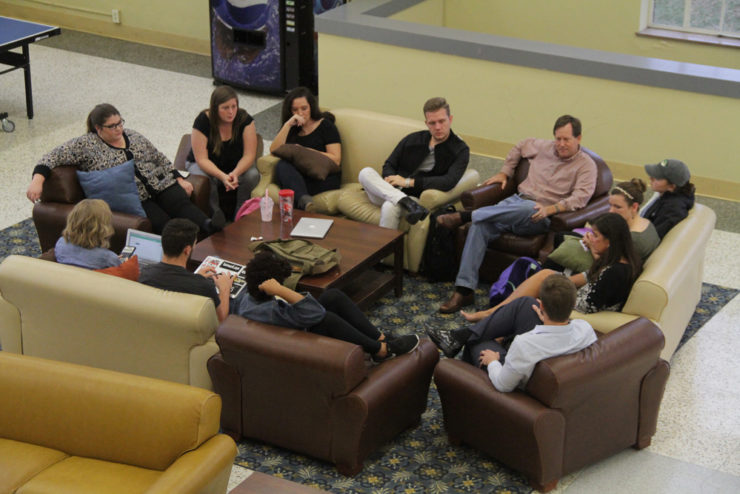 students seated in couches