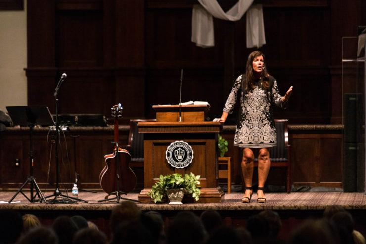 person speaking in chapel
