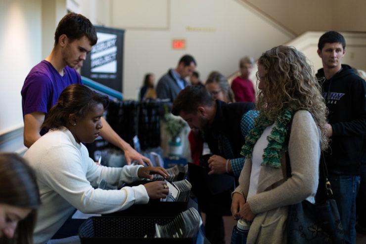 students getting brochures