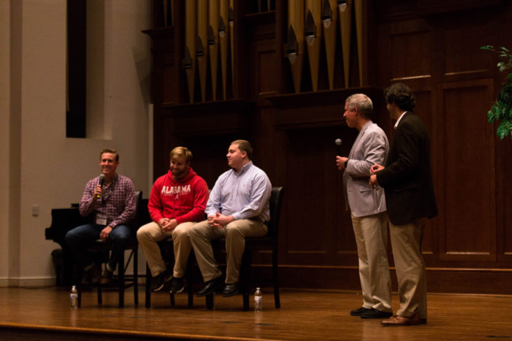 panel of students on stage