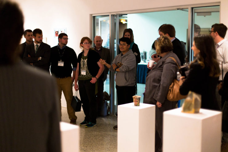 people standing in an art gallery