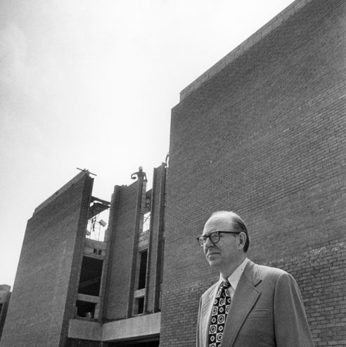 Dr. Kinlaw outside a building under construction