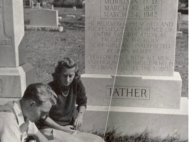 people sitting next to a gravestone