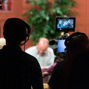 Students filming a live sitcom episode