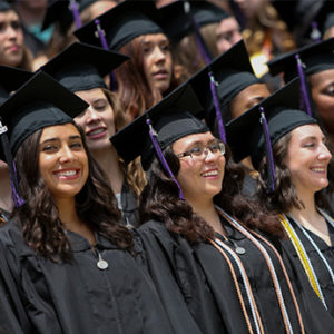 Graduates wearing caps and gowns smiling