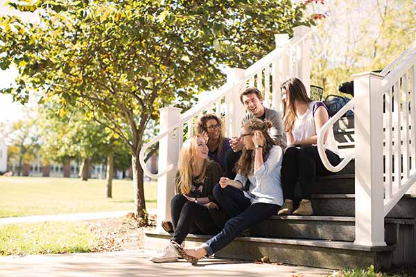 Students meeting and talking on steps