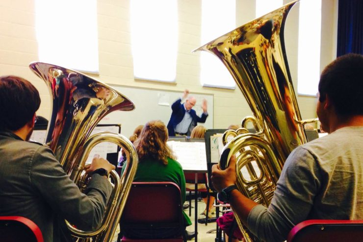student playing tubas