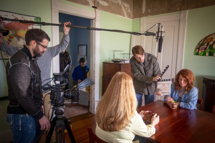 Students filming in a dining room