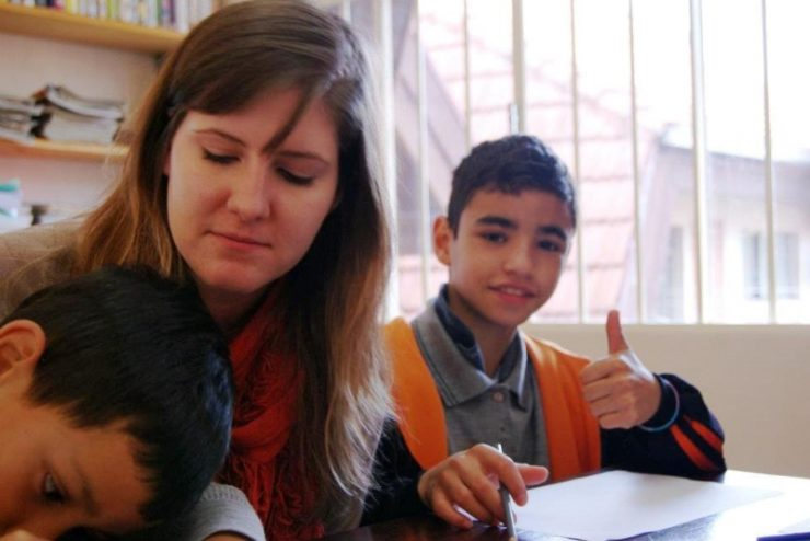 student helping children study