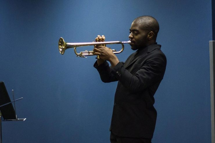student playing a trumpet
