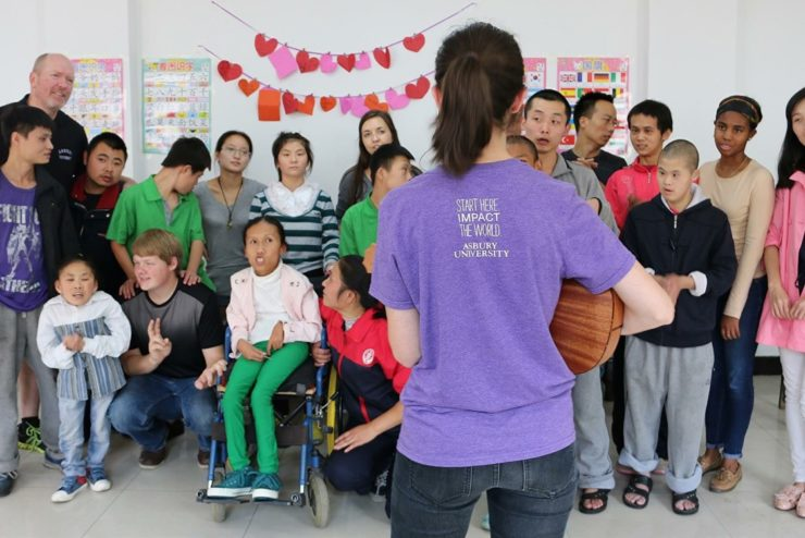 student leading people in singing